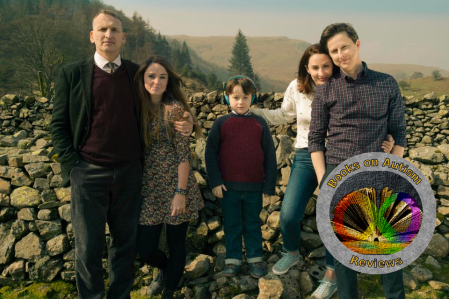 A photograph of the main cast from The A Word, from left to right there are: Maurice, Rebecca, Joe, Allison and Paul. They are standing in front of a stone wall.