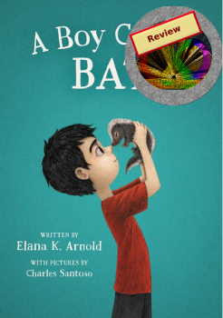 The front cover of the book has a boy with black hair wearing a red t-shirt and black trousers against a turquoise background. He is holding a skunk kit (baby) in his hands and their noses are pressed together.